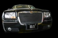 Chrysler 300 on black background with chrome mesh grille installed