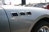Chrysler 300 with 3 rectangular port holes mounted on the front quarter panel
