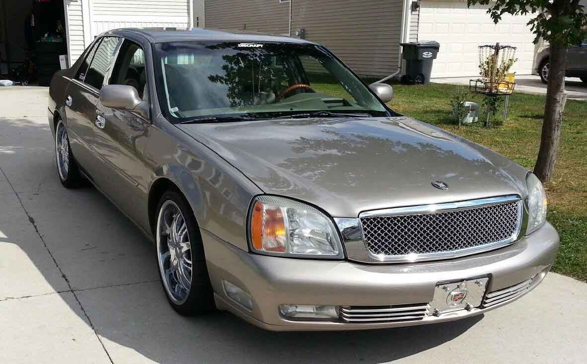 cadillac deville with chrome mesh grille installed